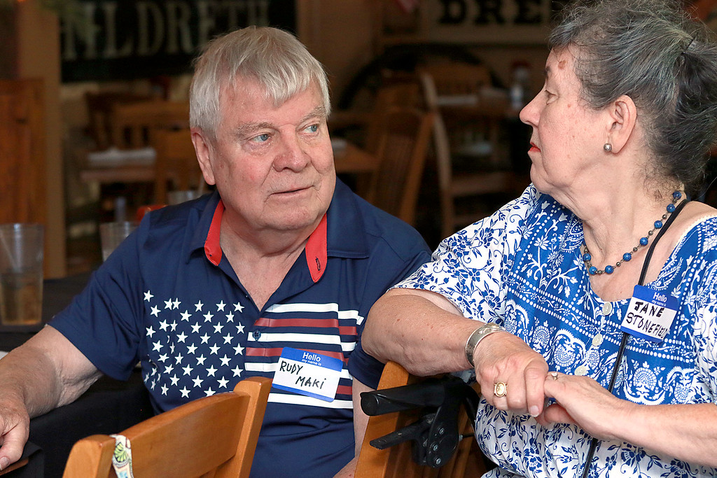 . The Townsend Spaulding High School class of 1958 at their 60 reunion held at the Townsend House in Townsend on Tuesday, June 19, 2018. Class members Rudy Maki and Jane Starfield chatted during the reunion. SENTINEL & ENTERPRISE/JOHN LOVE
