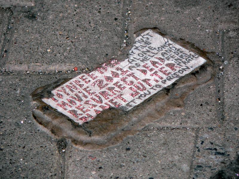 Sparkle paint tile on brick.