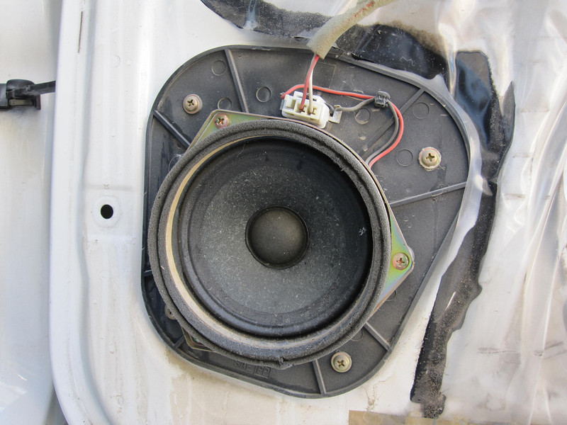 Rear door panel removed to expose stock speaker and mounting pod.