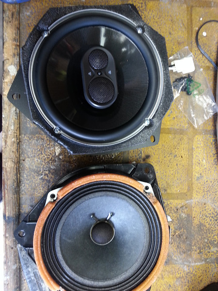 """OEM speaker and housing compared to aftermarket speaker, speaker baffle, and speaker adapter bracket   from  <a href=""""http://www.car-speaker-adapters.com/items.php?id=SAK036""""> Car-Speaker-Adapters.com</a>"""