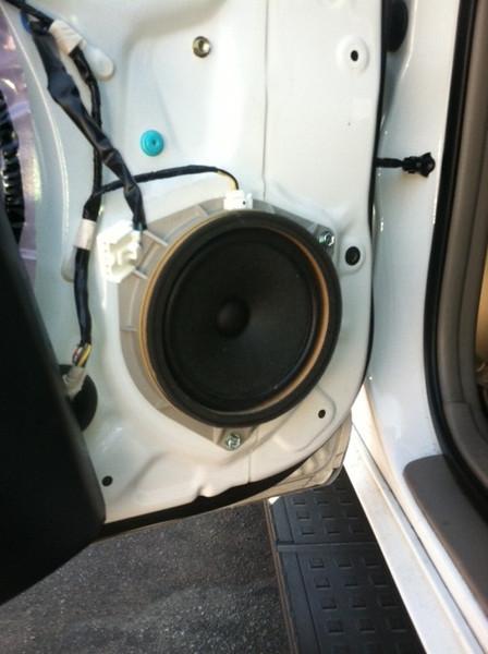 Door panel removed to expose OEM speaker.