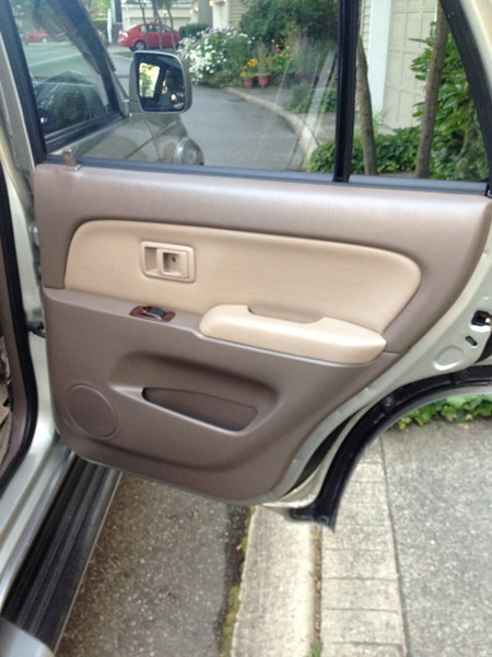 """Aftermarket 5.25"""" speaker needs to be spaced out due to clearance issue with the window (JL Audio TR-525CXI)."""