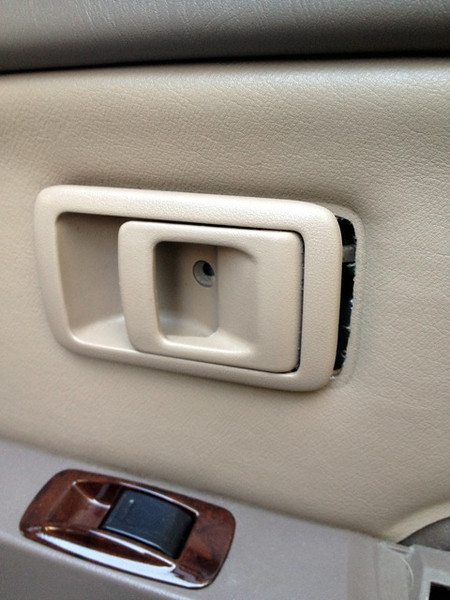 Push door handle towards the front of the car and pull out