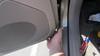 Prying lower portion of door panel