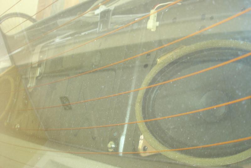 OEM speakers shown through rear window