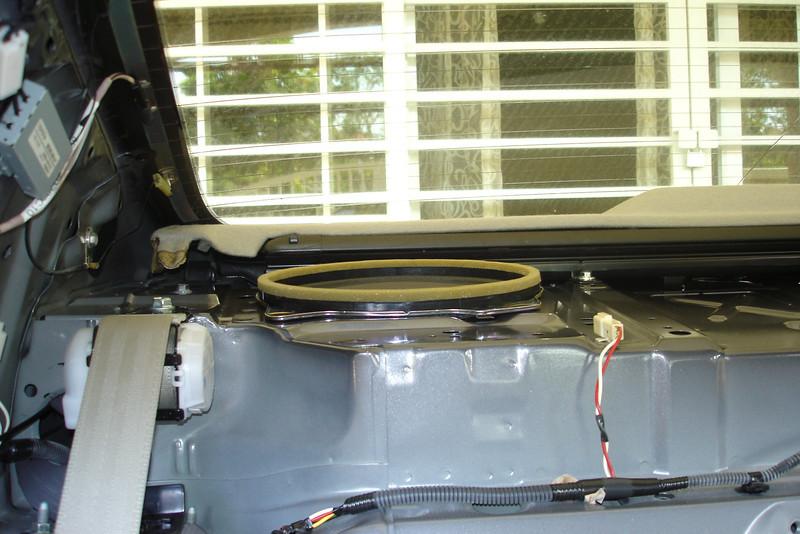 Trim panels removed<br /> OEM speaker shown