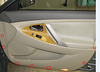 Next, pull off the door panel. Gently pull the panel until the fasteners snap out around the door.