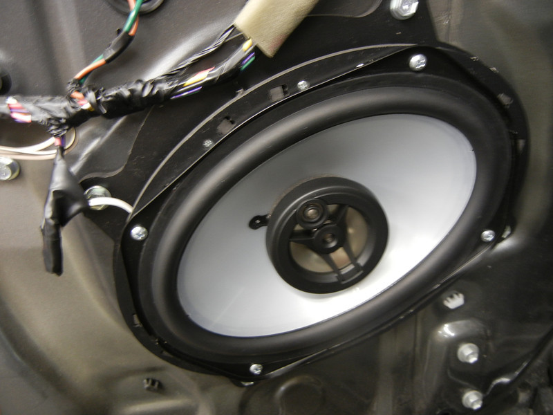 "Aftermarket speaker and speaker adapter  from  <a href=""http://www.car-speaker-adapters.com/items.php?id=SAK010""> Car-Speaker-Adapters.com</a>   mounted to driver side door"