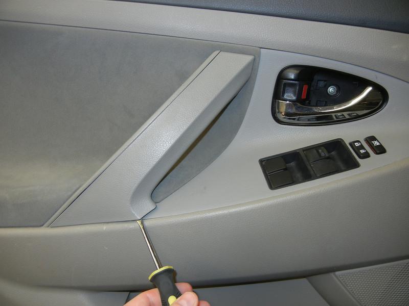 Removing door trim on driver side door