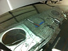 Rear deck panel removed to expose factory speakers.  Insulation around right rear factory speaker removed.