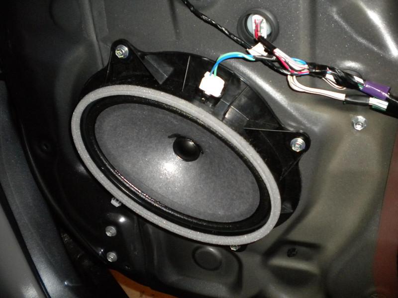 Door panel removed to expose factory speaker