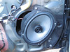 """Aftermarket speaker and speaker adapter  from  <a href=""""http://www.car-speaker-adapters.com/items.php?id=SAK010""""> Car-Speaker-Adapters.com</a>   partially mounted to door"""