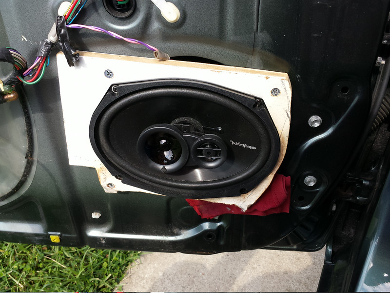 Aftermarket speaker and homemade MDF speaker adapter, to be replaced.