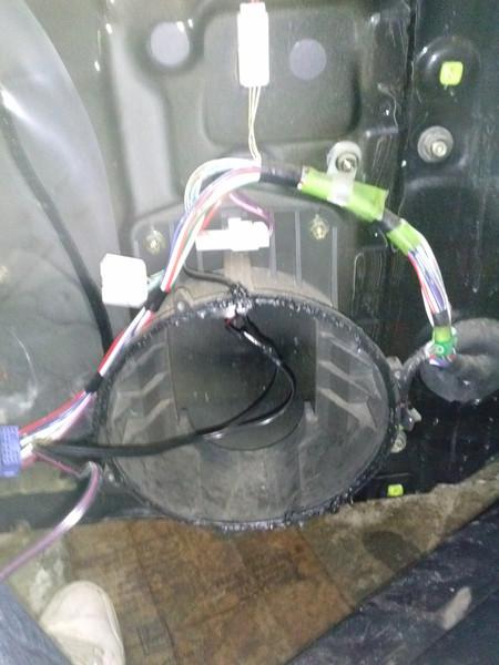 Factory speaker removed.  Factory door pod shown.