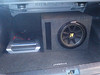 Kicker subwoofer and amplifier in trunk