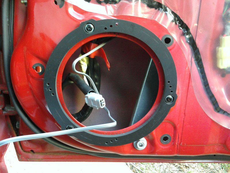 """Speaker adapter   from <a href=""""http://www.car-speaker-adapters.com/items.php?id=SAK069""""> Car-Speaker-Adapters.com</a>    installed on to door, and wiring roughed in."""