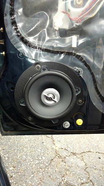 """Aftermarket speaker and speaker adapter  from <a href=""""http://car-speaker-adapters.com/items.php?id=SAK069""""> Car-Speaker-Adapters.com</a>  installed on door"""
