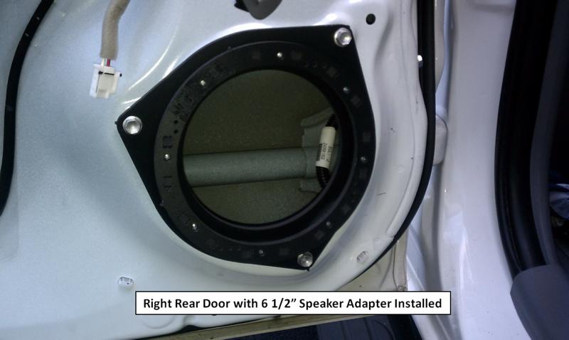 Closeup of speaker adapter mounted to door.