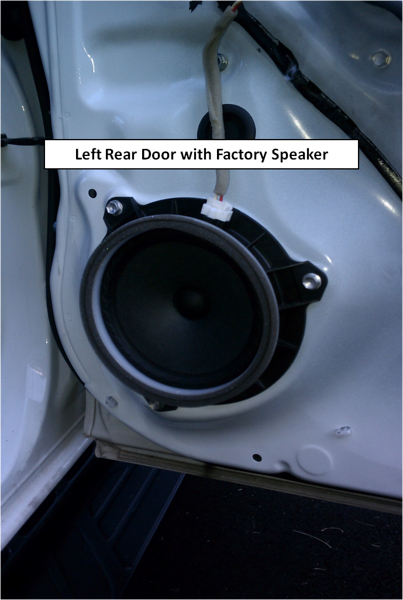 Rear door panel removed to expose factory speaker.
