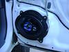 Aftermarket speaker and speaker adapter installed in vehicle.