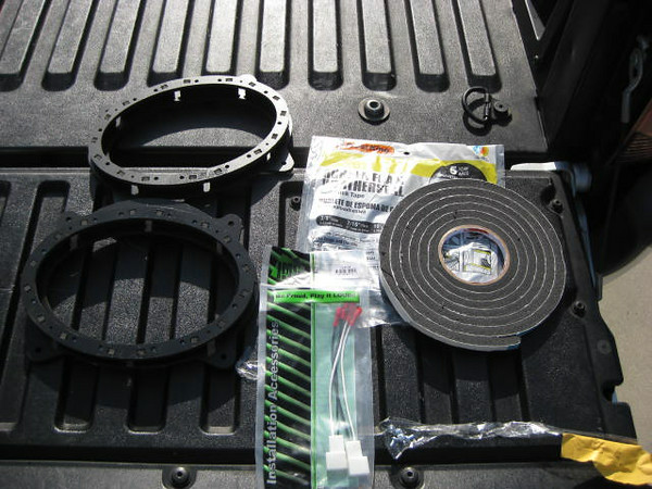 """Left: Speaker adapters  from <a href=""""http://www.car-speaker-adapters.com/items.php?id=SAK010""""> Car-Speaker-Adapters.com</a> <br> Middle: Wiring harness / plug <br> Right: Foam weatherstripping sealant tape"""