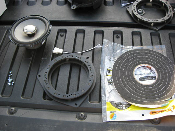 "Supplies needed for speaker installation. <br> Left: Aftermarket speaker <br> Middle: Wiring harness / plug and speaker adapter    from  <a href=""http://www.car-speaker-adapters.com/items.php?id=SAK036""> Car-Speaker-Adapters.com</a>  <br> Right: Foam sealant Weatherstripping tape"