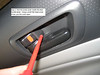 Step 2: find the screw cover inside the door handle bezel.  Using a small flat head screw driver, pry the cover open.