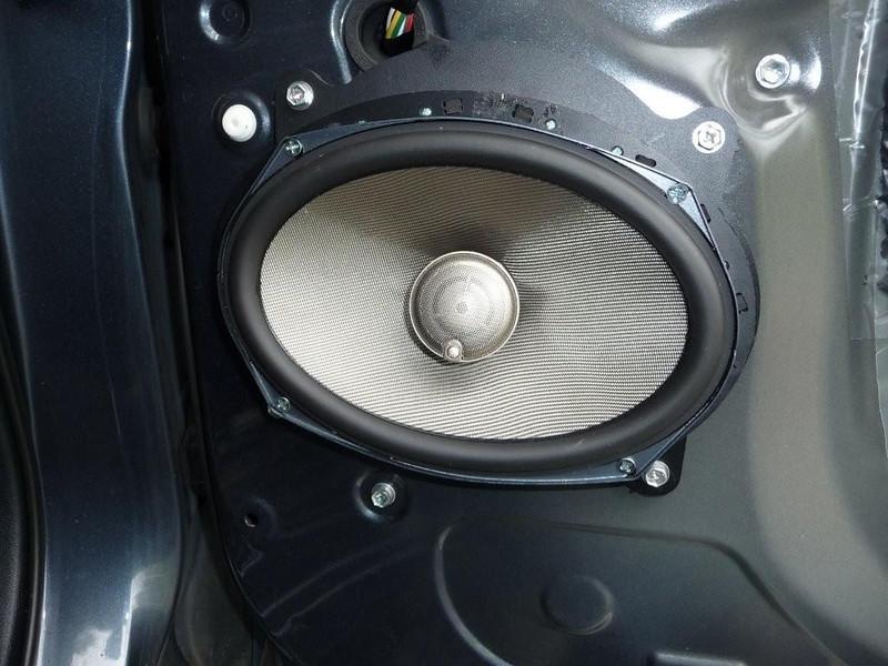 Aftermarket speaker and speaker adapter installation complete.