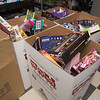 5 boxes of toys sit near the cash register of R/C excitement in Fitchburg during the 2nd annual Toys for Tots race between Fitchburg Mayor Stephen DiNatale, Fire Chief Kevin Roy, and Police Chief Ernest Martineau on Sunday. (Sentinel & Enterprise photo/Jeff Porter)