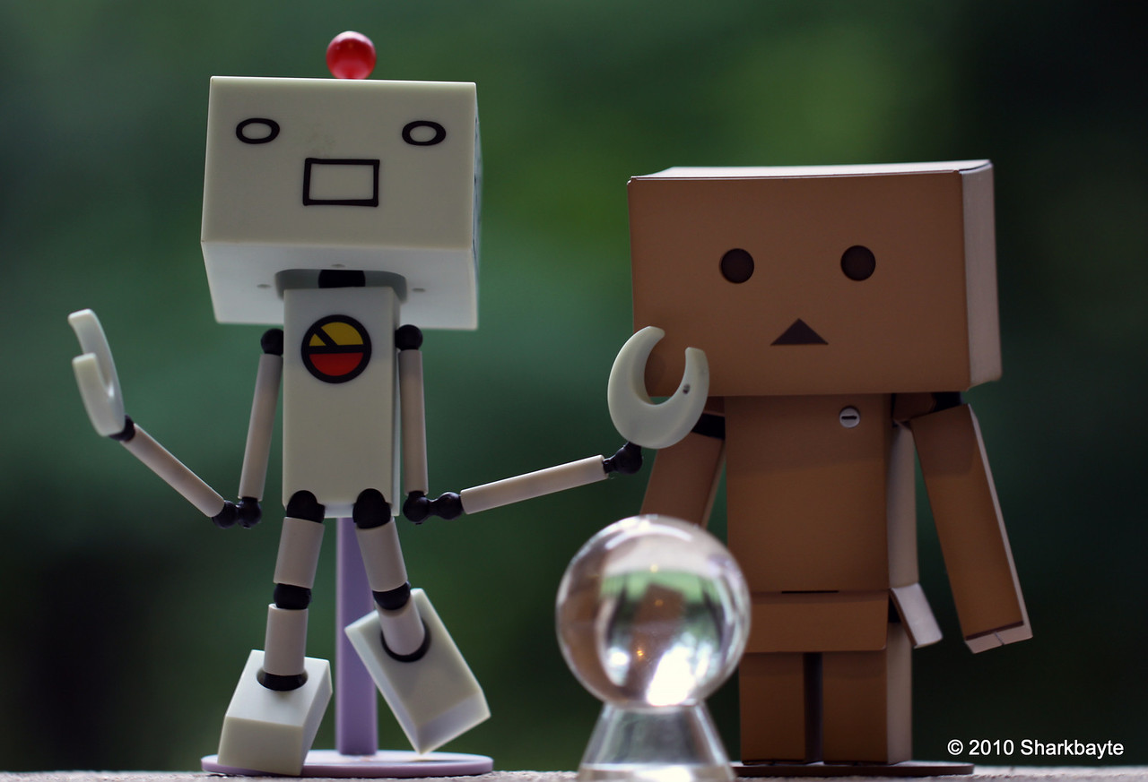 Day 166-The reading. Suzuki believes that he can see the future using a crystal ball. Danboard thinks Suzuki has a few fried circuits. (2010.06.15) #365Project @sharkbayte