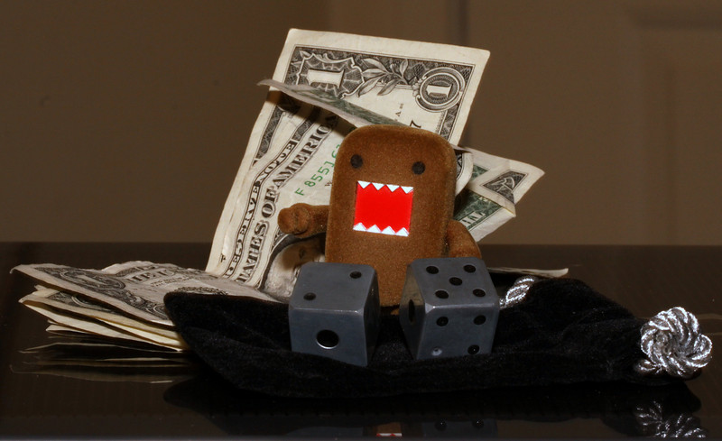 #365Project  Day 125/365- Domo rolls a lucky 7! (who gave him money?) Got this pair of dice as a prize from who knows where. It comes in that neat case and came with a small book of dice games. Thank you all for all the kind comments on my pics the past few days.