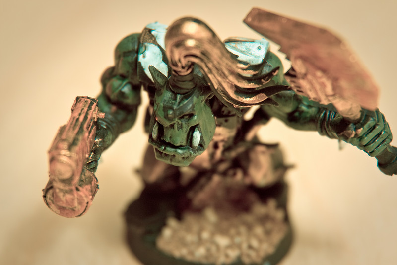 A Warhammer 40,000 figure hand painted by Jonathan (with some photographic treatment).