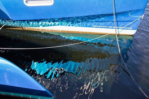 Reflection Of The Sailing Boat
