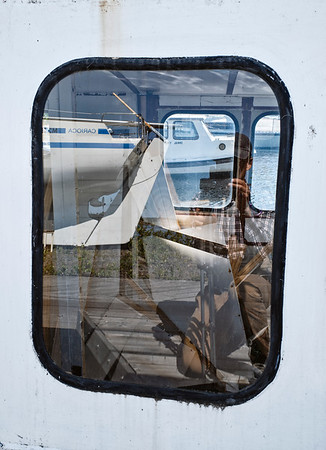 Reflection Of The Boat And Photographer