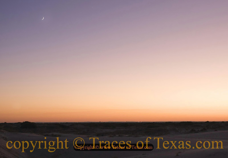 Title:   Moon Over Monahans<br /> <br /> Comments: Soft summer evening, breeze gently blowing, sand drifting  ... I am living large.<br /> <br /> Location: Monahans