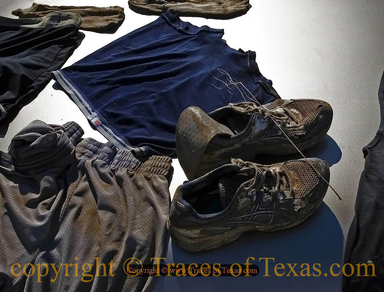 Title:   Muddy Buddy Madness<br /> <br /> Comments: Every year, a bunch of Texans gather in Dripping Springs, roll around in a giant mud pit, and call it a race.  This is the aftermath.<br /> <br /> Location: Dripping Springs, Texas