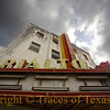 Title:   The Mighty Are Sometimes Laid Low<br /> <br /> Comments: The old Rialto theather in Sinton has gone through several iterations over the decades, having been built in the 1920's, razed by fire in 1945, rebuilt, become a movie rental store etc... It is now empty --- and deteriorating. <br /> <br /> Location: Sinton, Texas