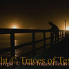 Title:   Life, The Universe, and Live Bait vs. Artificial Lures<br /> <br /> Comments: A lone fisherman ponders his existence on a misty Horace Caldwell Pier in Port Aransas. No matter: he caught a nice speckled trout for dinner. <br /> <br /> Location: Port Aransas