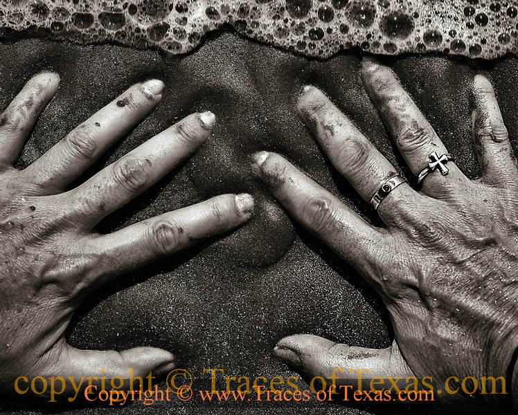 Title: Watching the Tide Roll Away<br /> <br /> Comments: Hands in the surf.<br /> <br /> Location: Mustang Island, Texas