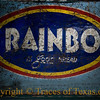 Title: Rainbo is Good Bread<br /> <br /> Comments: This sign on an old store door has seen better days.<br /> <br /> Location: Helotes