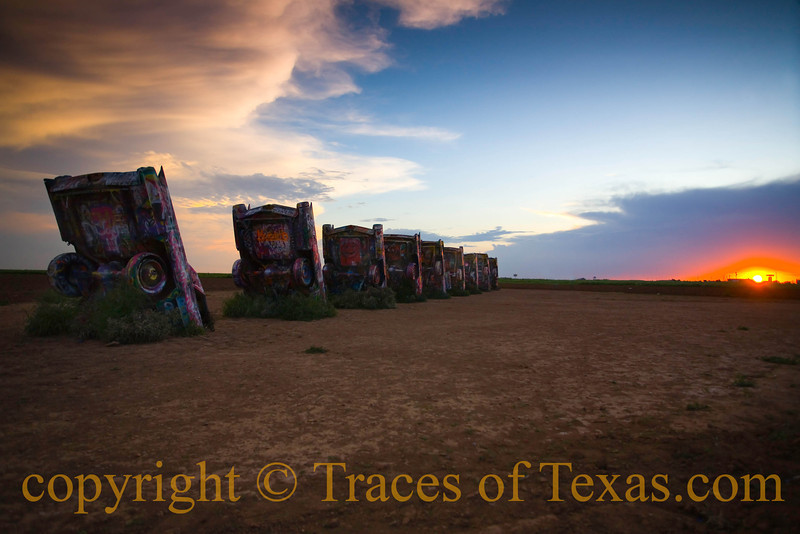 """Title: Didn't Life take an Unreal Turn at Some Point?<br /> <br /> Comments: I am told that the Cadillac Ranch is """"a statement about the paradoxical simultaneous American fascinations with both a """"sense of place and roadside attractions (like The Ranch itself) and the mobility and freedom of the automobile.""""  <br /> <br /> Personally, I think it's more of a statement about how crazy some Texans are. <br /> <br /> Location: Amarillo"""