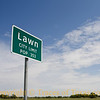 Title: Lawn City Limits<br /> <br /> Comments:  The yards in this town are to die for.  Also, I find that many people are confused as to where Lawn is. It's about five miles southeast of Ovalo. <br /> <br /> Location: Lawn