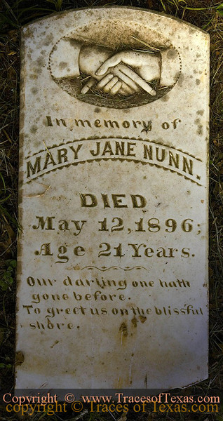 """Title:   In Memory of Mary Jane Nunn<br /> <br /> Comments: The tombstone is inscribed """"Our Darling One Hath Gone Before, to Greet Us on the Distant Shore.""""   I have seen this exact same inscription on many tombstones hereabouts.  <br /> <br /> Location: In a rural black cemetery near Sweet Home."""