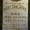 "Title:   In Memory of Mary Jane Nunn<br /> <br /> Comments: The tombstone is inscribed ""Our Darling One Hath Gone Before, to Greet Us on the Distant Shore.""   I have seen this exact same inscription on many tombstones hereabouts.  <br /> <br /> Location: In a rural black cemetery near Sweet Home."