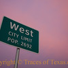 Title: West City Limits<br /> <br /> Comments: Many say that West is the source of the best kolaches in the state, a mighty big claim hereabouts. There have been moments when I agreed.  I was fortunate enough to be passing through as the sun was setting in a purple and crimson sky. <br /> <br /> Location: West