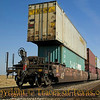 """Title:   Don't You Know Me? I'm Your Native Son<br /> <br /> Comments:  Incongruity: right here, parked in the middle of nowhere, were boxcars painted """"China Shipping.""""  <br /> <br /> Location: Oh, somewhere along the Llano Estacado"""