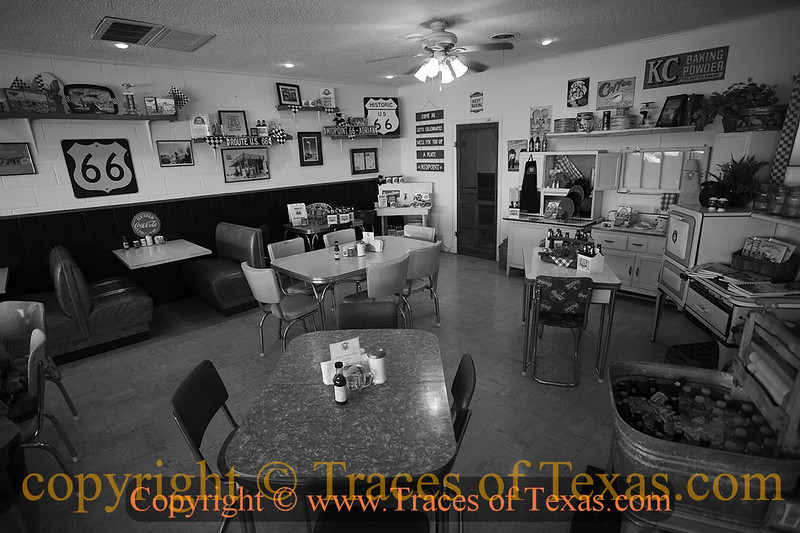 """Title:   You're Halfway Home<br /> <br /> Comments:  The Midpoint Cafe is midway between Chicago and Los Angeles on Route 66. It's 1,139 miles to both cities. As you can see, it has """"roadside classic"""" ambiance. <br /> <br /> Location: Adrian, Texas"""