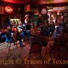 Title:  ..... Just to Watch Him Die<br /> <br /> Comment: Cowboys jamming on a lazy Saturday afternoon.  The bartender told me that, occasionally, somebody rides up to the bar on his horse. I believed him.  <br /> <br /> Location: Bandera