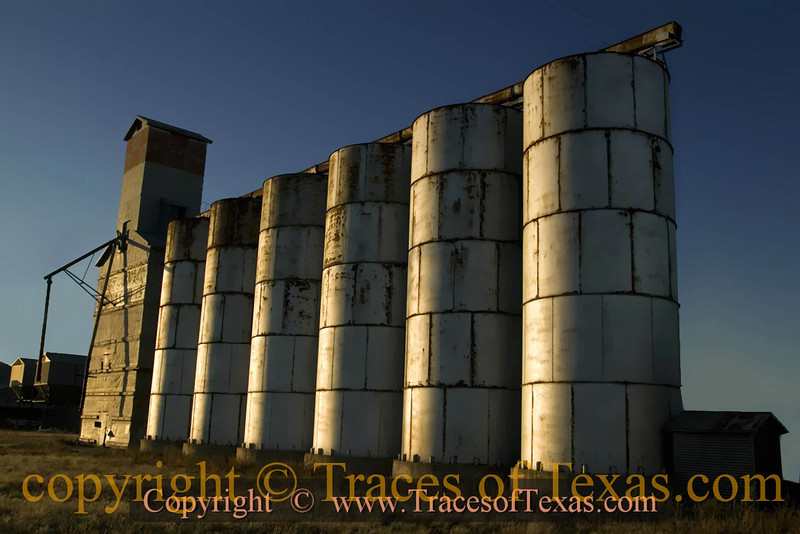 Title:   Slip Slidin' Away<br /> <br /> Comments: Old grain silos just fading away ....<br /> <br /> Location: