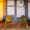 Title:   Just Sittin' Here Watching the Wheels go Round and Round<br /> <br /> Comments:  What could be better than sitting in an old chair at sundown with a cold glass of lemonade and chatting with passersby?<br /> <br /> Location: Abbott